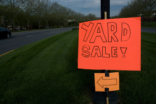 Bright orange yard sale sign