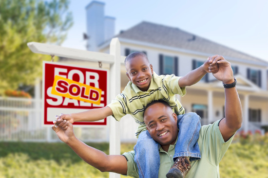 Father and son celebrating house sale