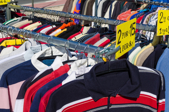 Clothes on rack at yard sale