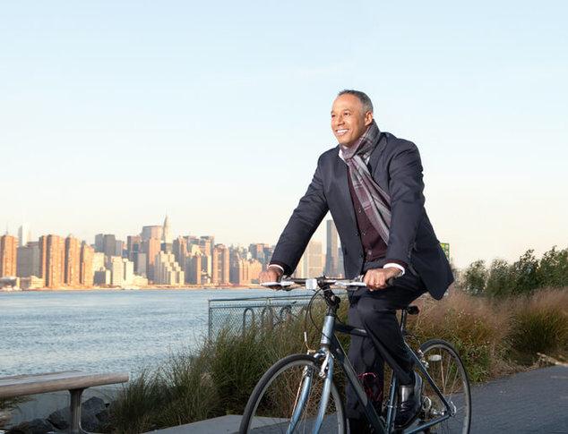 man riding bike to work