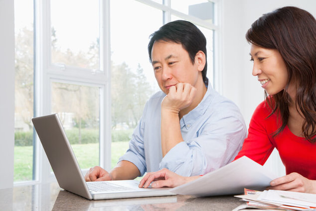 couple doing finances on computer