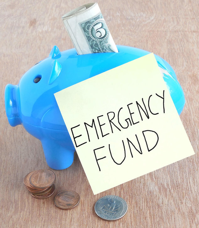 a blue piggy bank with an emergency fund note