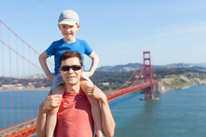 Father and son tourists visit the Golden Gate Bridge