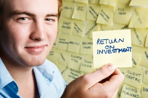"Young investor with note that says ""return on investment"""