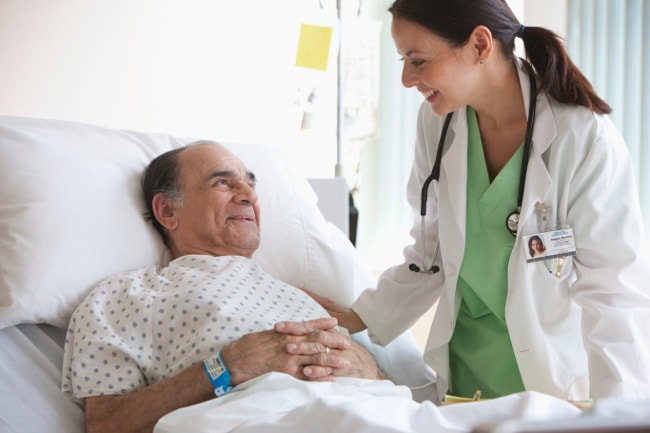 Nurse checking on patient