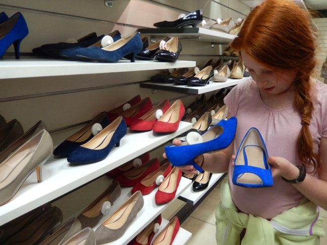Girl shopping for shoes