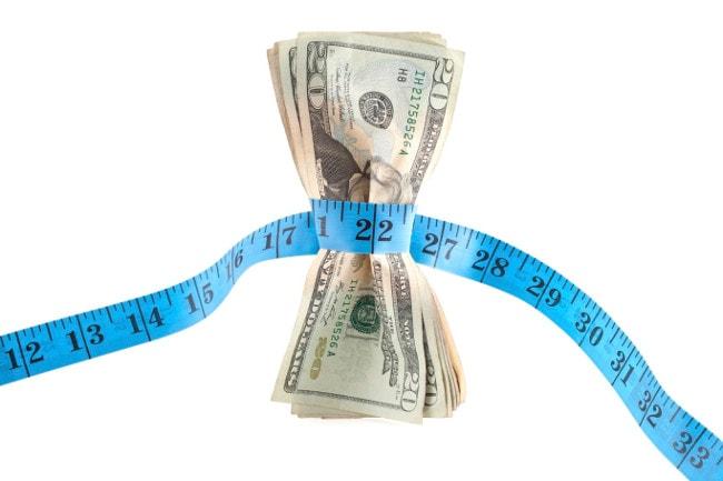 Tape measure around $20 bills