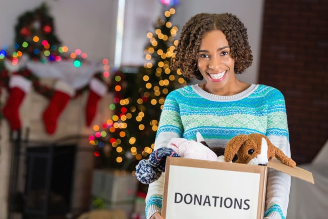 Woman gathering toys to donate after Christmas
