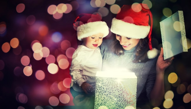 Mother and child opening sparkly Christmas present