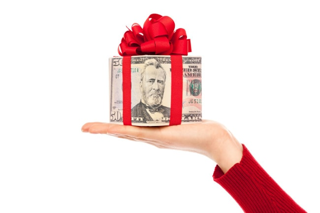 $50 bill with red ribbon as gift