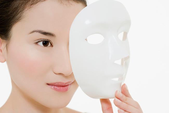 Woman removing mask