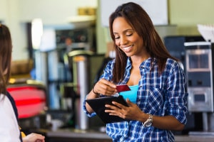 Woman consider which credit card to use