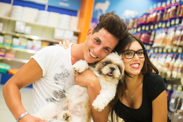 Excited couple shopping for dog toys