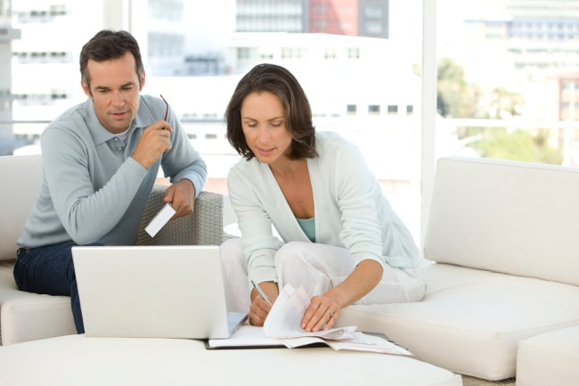 Couple at home managing finances
