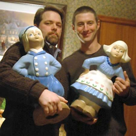 [photo of my friend and me holding garden statues]