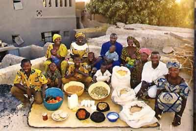 [photo of Malian family with a variety of grains]