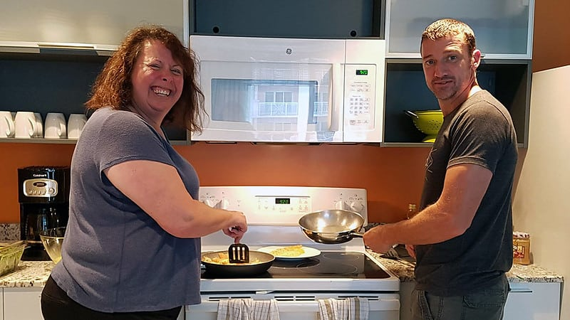 Marla and Pete, making breakfast in Clearwater