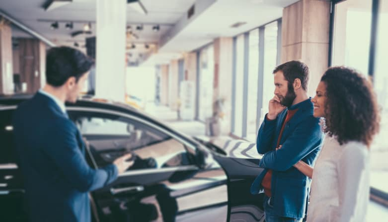 At the dealership, evaluate the car and the salesperson. (Photo from Getty Images.)